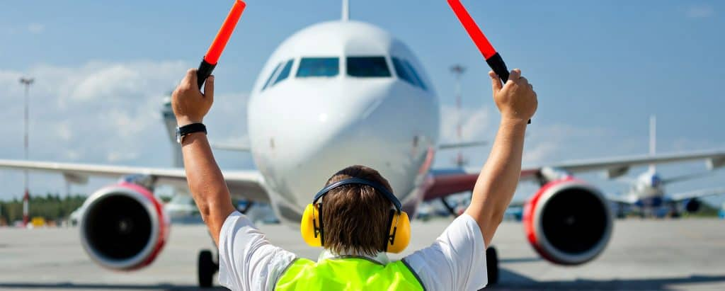 Ground Handling Agent Directing Plane